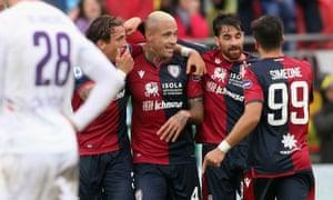 Radja Naiggolan (centre) celebrates his goal with teammates during Cagliari's 5-0 defeat of Fiorentina in their Seria A match on Sunday.