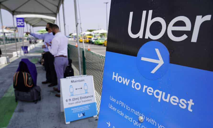 Travelers request Uber rides at Los Angeles international airport.