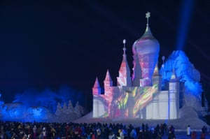 Tourists visit the Harbin International Snow Sculpture Art Expo to celebrate the new year at Harbin Sun Island park on December 31, 2017 in Harbin,China.