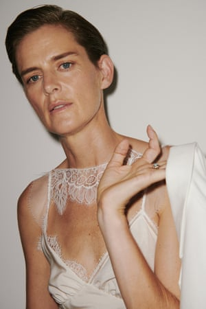 Stella Tennant opened the show in a lace-trimmed satin camisole, worn under a crisp wide-leg trouser suit.
