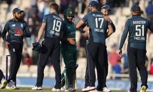 England players celebrate winning by 12 runs.