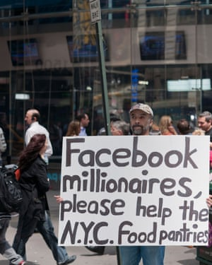A protester outside the Nasdaq headquarters in New York marks Facebook's IPO, 2012
