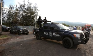 Federal police leaving the ranch where on 22 May 2015 a clash between police and drug cartel suspects ended with 43 people dead.