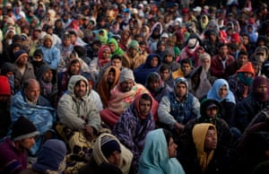 Men from Bangladesh, who used to work in Libya but recently fled as unrest spread, wait in a refugee camp in Ras Ajdir on the Tunisia-Libya border for information about their repatriation.