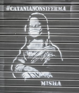 Catania, Italy The Mona Lisa with a face mask