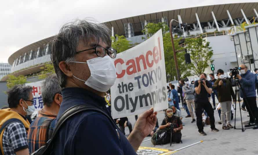 People holding placards protest against the Tokyo Olympic Games