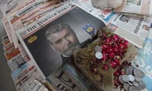 A newspaper with a frontpage advertisment featuring Pierce Brosnan endorsing an Indian mouth freshener.
