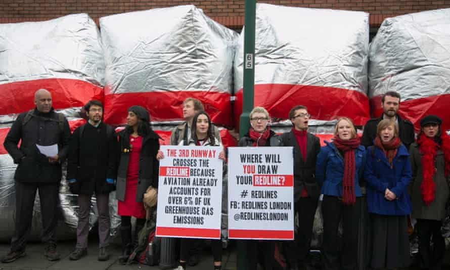 Cheering supporters outside Willesden Magistrates Court as the trial of 13 protesters began on 18 January 2016.