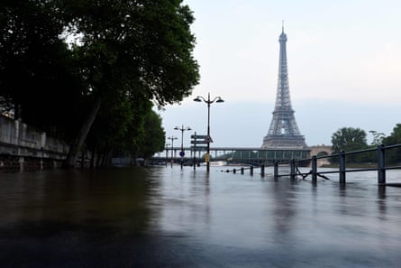 The Eiffel Tower in front of the flooded Seine river in Paris on June 3 2016