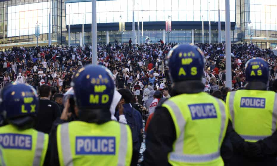 Police watch supporters outside Wembley Stadium