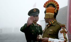 File photo of a Chinese soldier and Indian soldier at the Nathu La border crossing between India and China.