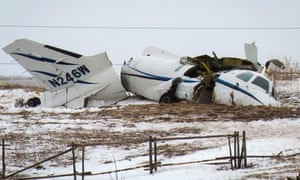 The wreckage of an airplane lies in a field in Havre-aux-Maison, Quebec. All seven people onboard the plane, including former Canadian transport minister Jean Lapierre, died in the crash.
