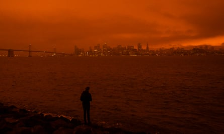 Smoke blankets the San Francisco skyline in darkness and an orange glow on 9 September.