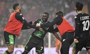 Jeremie Boga is mobbed by teammates after scoring Sassuolo's fourth against Roma.