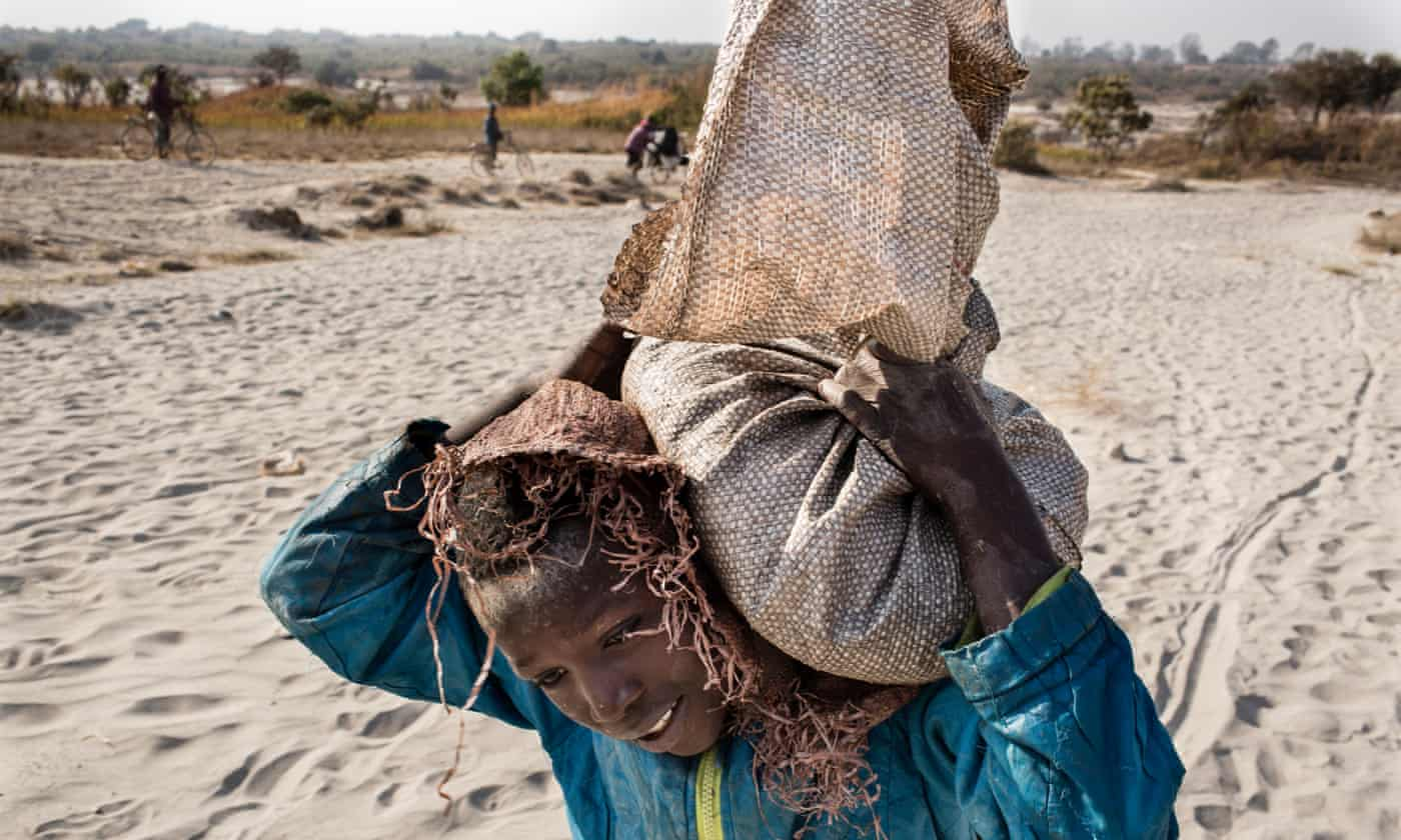 An 11-year-old boy ferrying sacks of cobalt to a depot in the DRC.