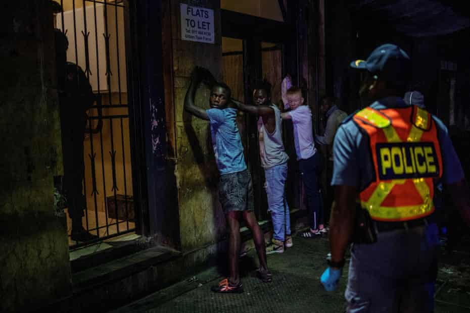 Suspects are arrested for defying the lockdown during an operation in Johannesburg in South Africa.