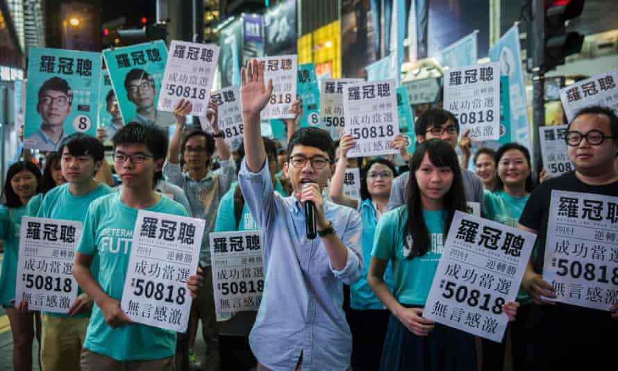 Nathan Law speaks at a rally with Joshua Wong to his left in Causeway Bay following Law's win in the Legislative Council election in Hong Kong on 5 September.
