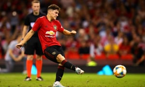 Daniel James scores from the spot to earn a shooutout victory over Milan in Cardiff.
