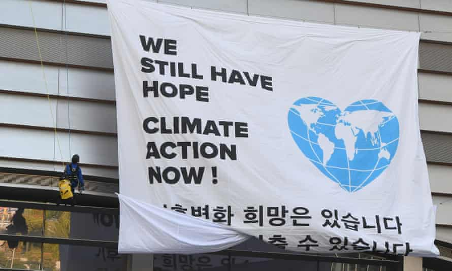 Greenpeace activists display a banner for climate action ahead of the IPCC meeting in Incheon, South Korea