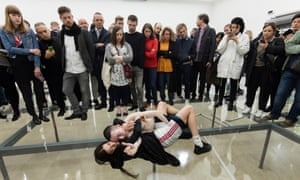 Faust, Anne Imhof's work at the German Pavilion, won the Golden Lion. Action, from slaps to tussles top singing, takes place above and below the glass floor.