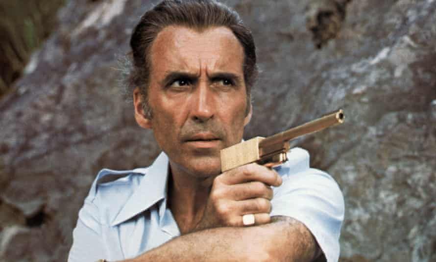 Christopher Lee as Scaramanga in The Man With the Golden Gun (1974). Peter Lamont commissioned the gun prop and taught Lee how to assemble it.