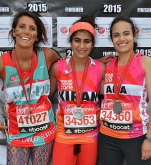 Runner Kiran Gandhi (centre) who free-bled in the 2015 London Marathon.