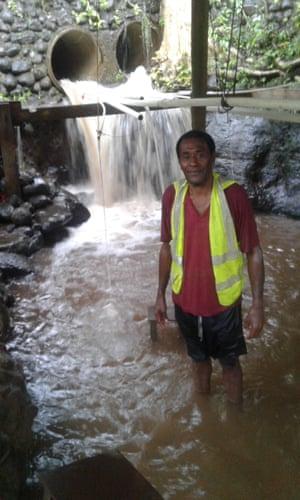 Menausi Druguvale, a voluntary guide from the village of Delakado, Fiji stands in a 'miracle' spring which locals say as healing properties.