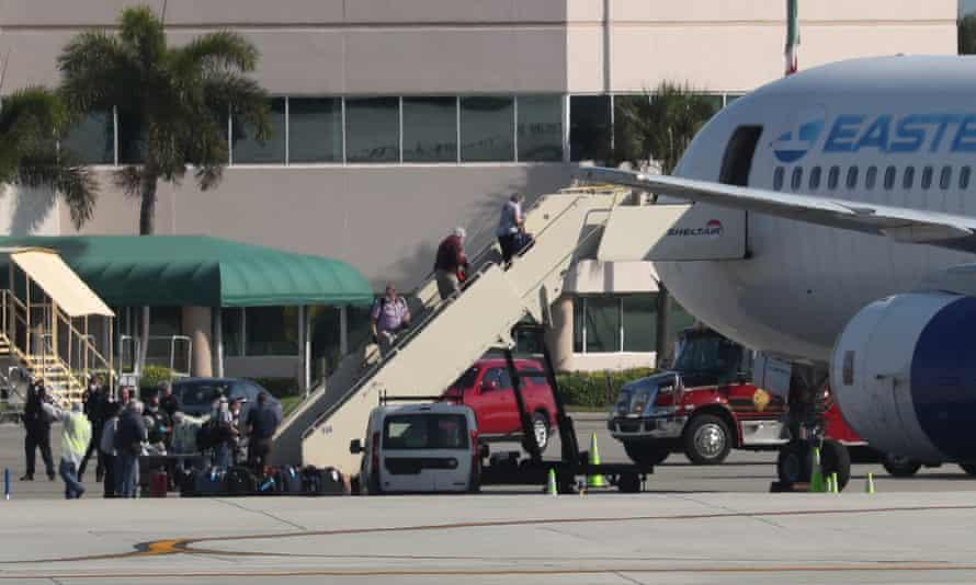 Passengers from the Zaandam and Rotterdam cruise ships board a charter flight in Florida.