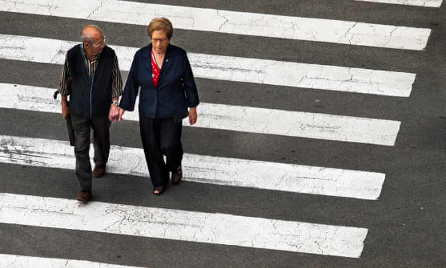 old couple cross the road