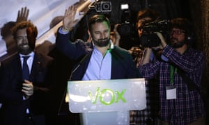 Santiago Abascal, leader of far right party Vox, waves to supporters gathered outside the party headquarters waiting for results of the general election in Madrid, Sunday, April 28, 2019.