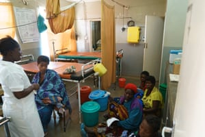 Ruth Anderson (seated), and women who have given birth and are waiting to be discharged, Ngokwe Health Centre, Machinga, Malawi