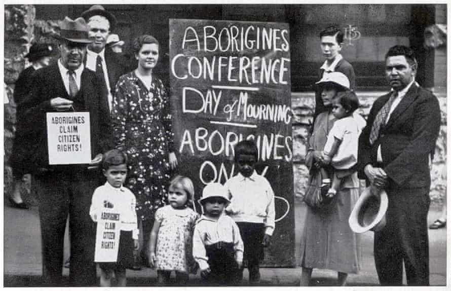 Meeting organised by the Aborigines Protection Association in the Australian Hall Sydney on 26 January 1938. From left William Ferguson, Jack Kinchela, Isaac Ingram, Doris Williams, Esther Ingram, Arthur Williams, Phillip Ingram, Louisa Agnes Ingram OAM holding daughter Olive Ingram and Jack Patten.