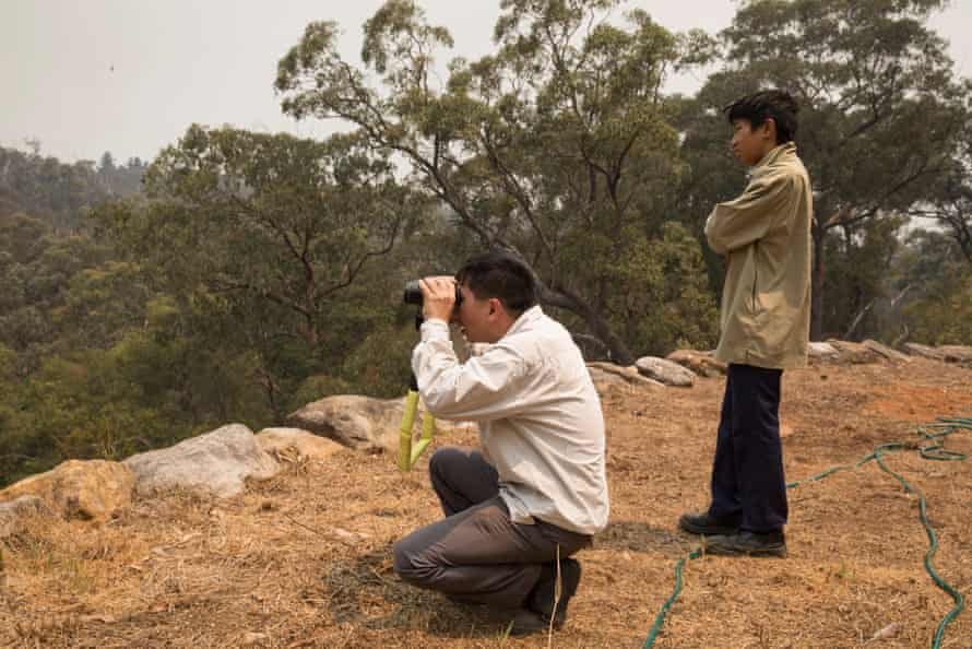 Justin and Gabriel watch the fire approaching on Friday
