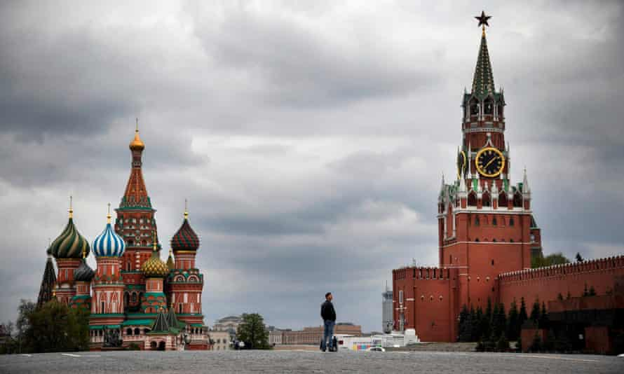 A man walks on an empty Red Square in downtown Moscow