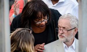 Diane Abbott has her hand on Jeremy Corbyn's shoulder as they speak