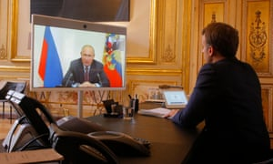 Emmanuel Macron listens to Vladimir Putin during a video call at the Elysée Palace.