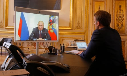 Emmanuel Macron listens to Vladimir Putin during a video call at the Elysée Palace.
