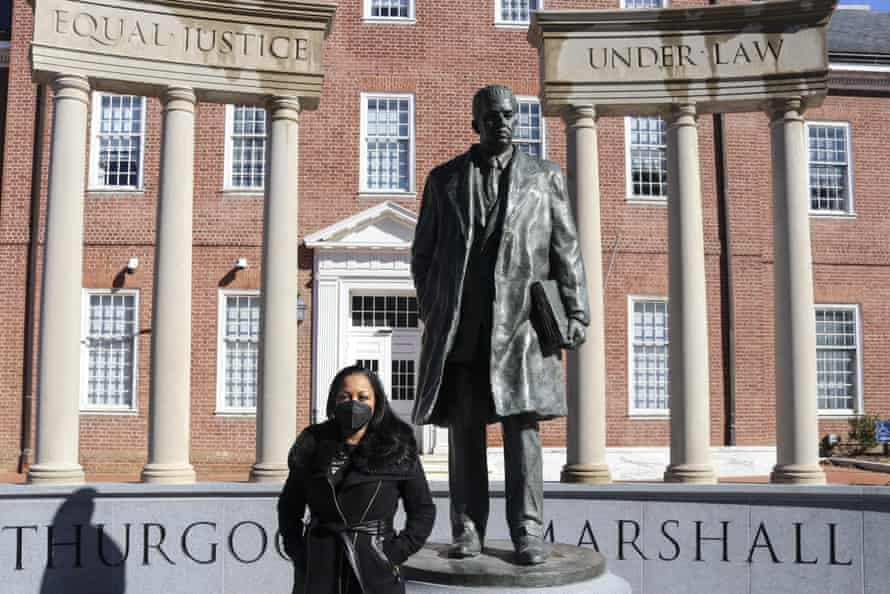 Maryland state delegate Vanessa Atterbeary stands by a statue of former supreme court justice Thurgood Marshall in Annapolis, Maryland.