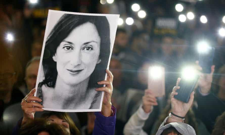 Protesters hold picture of Daphne Caruana Galizia