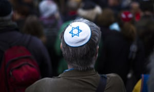 A man wears a kippah as he attends a demonstration against an antisemitic attack in Berlin in 2018.