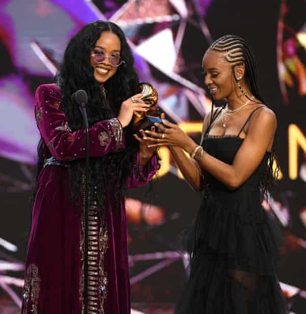 HER and co-writer Tiara Thomas accept the song of the year award for I Can't Breathe.
