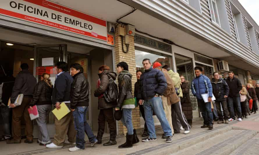 Jobseekers queue outside a state employment centre in Madrid