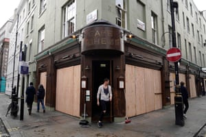 A cafe is boarded up in central London