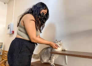 A woman plays with a cat