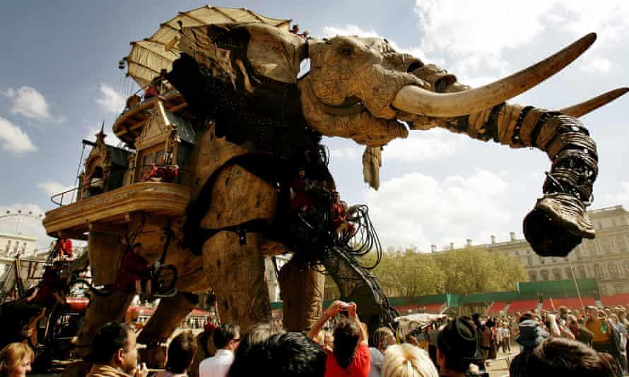 Royal de Luxe's giant mechanical puppet paces through London.
