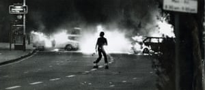 A roller skater on the streets of Brixton in London during the riots of 1985