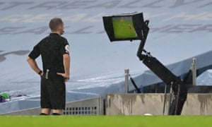 Referee Craig Pawson refers to VAR