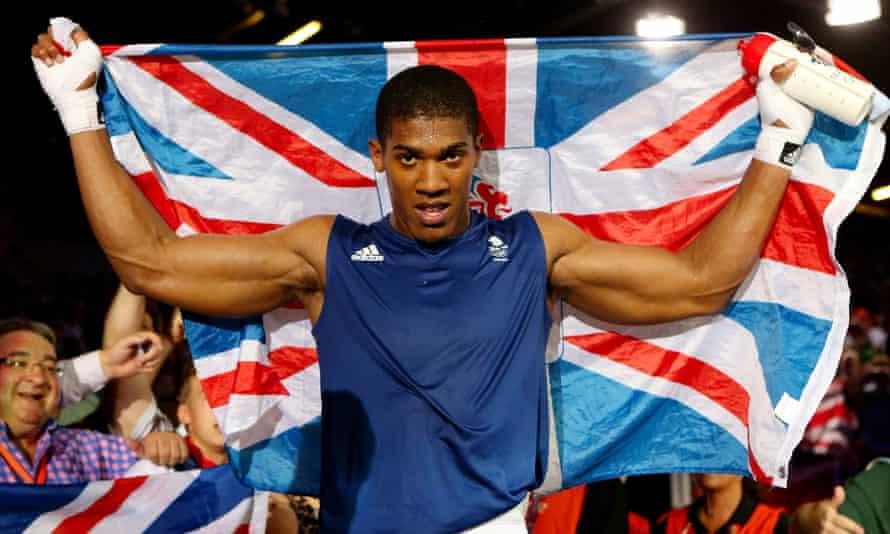 Golden gloves: Joshua defeats Italy's Roberto Cammarelle to win the men's super heavy final at the London Olympics.