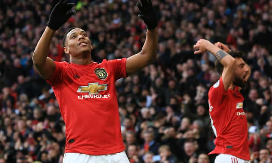 Anthony Martial (left) celebrates scoring  Manchester United's first goal, a volley from a free-kick.