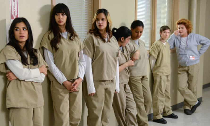 (L-R) Diane Guerrero, Jackie Cruz, Dascha Polanco and Kate Mulgrew (far right) in a scene from Netflix s Orange is the New Black Season 2. Photo credit: Ali Goldstein for Netflix.